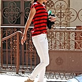 Katie donned a red-and-navy-striped Madewell top with white skinny jeans, then completed her all-American look with Rag & Bone booties, black shades, and a simple gold pendant in April 2012.