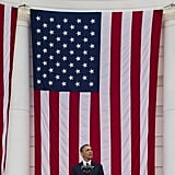 The president stood among American flags.