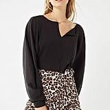 UO Leopard Ruffle Wrap Skirt