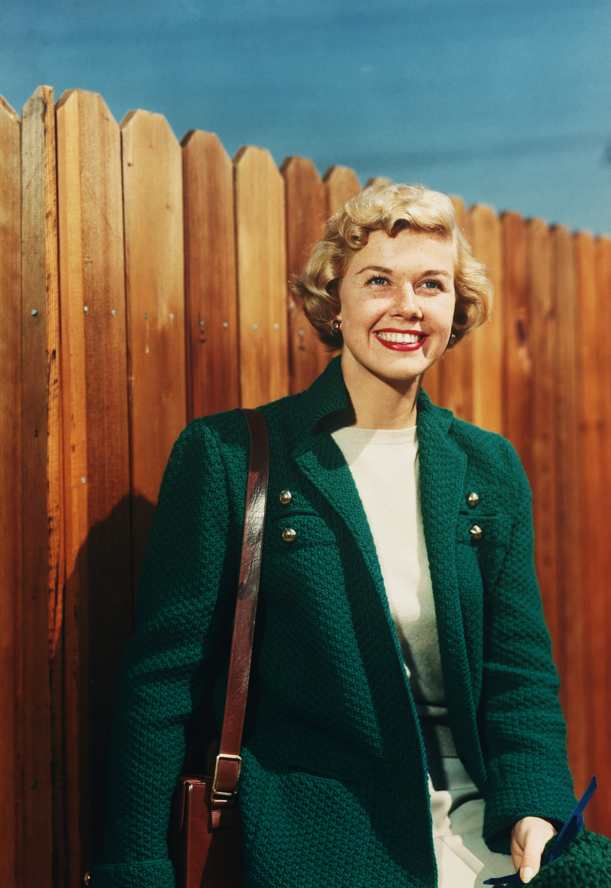 Doris Day in Green Jacket by Fence (Photo by Herbert Dorfman/Corbis via Getty Images)