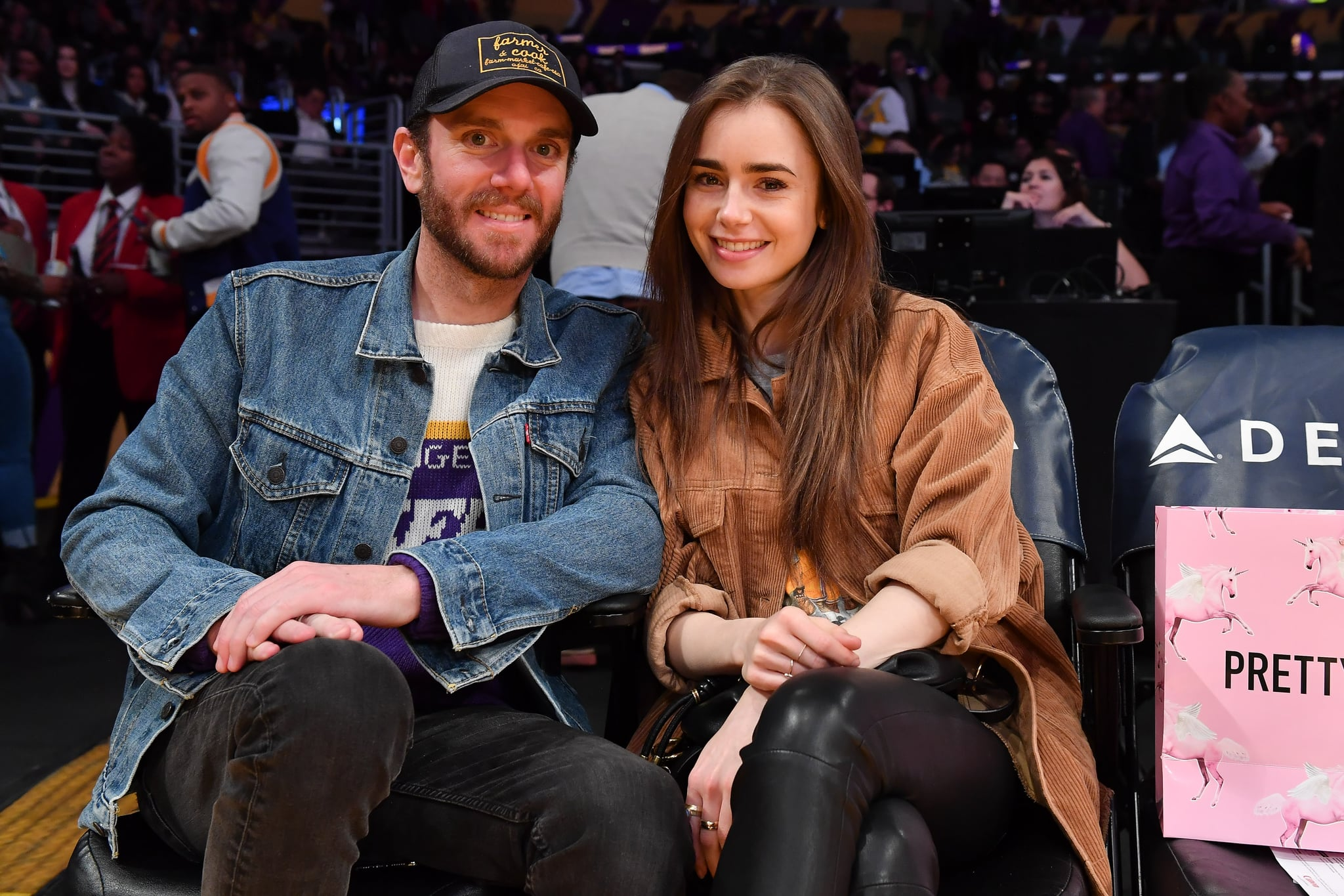 LOS ANGELES, CALIFORNIA - JANUARY 13: Lily Collins and Charlie McDowell attend a basketball game between the Los Angeles Lakers and the Cleveland Cavaliers at Staples Centre on January 13, 2020 in Los Angeles, California. (Photo by Allen Berezovsky/Getty Images)