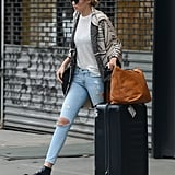 The skinny jeans and ankle boot look isn't dead yet. Gigi wore it as her travel outfit, complete with a cardigan and t-shirt.