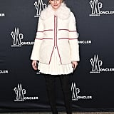 For the Moncler show, Olivia played the part in a chic white jacket and coordinating mini.