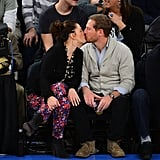 Drew Barrymore planted a kiss on her husband, Will Kopelman, as they sat courtside at a NY Knicks game in January.