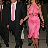Melania's halter-style, knee-length dress was complete with a gold brooch when she stepped out in Miami in 2005.