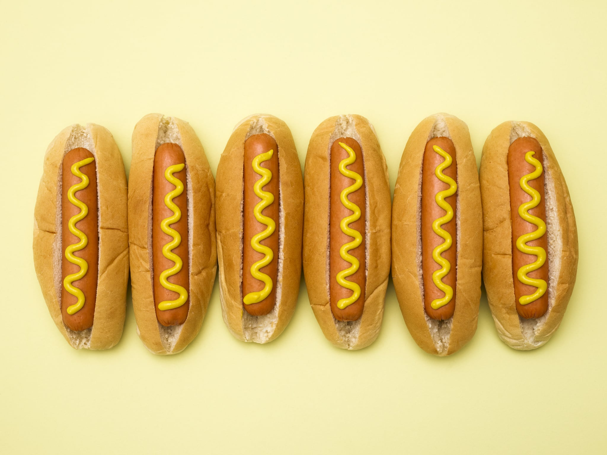 Hot dogs against a plain background.