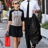 For an LA afternoon, Reese topped a black swing skirt with a snakeskin Jason Wu sweatshirt and studded Valentino flats, then added a splash of color via a crimson Jason Wu tote.