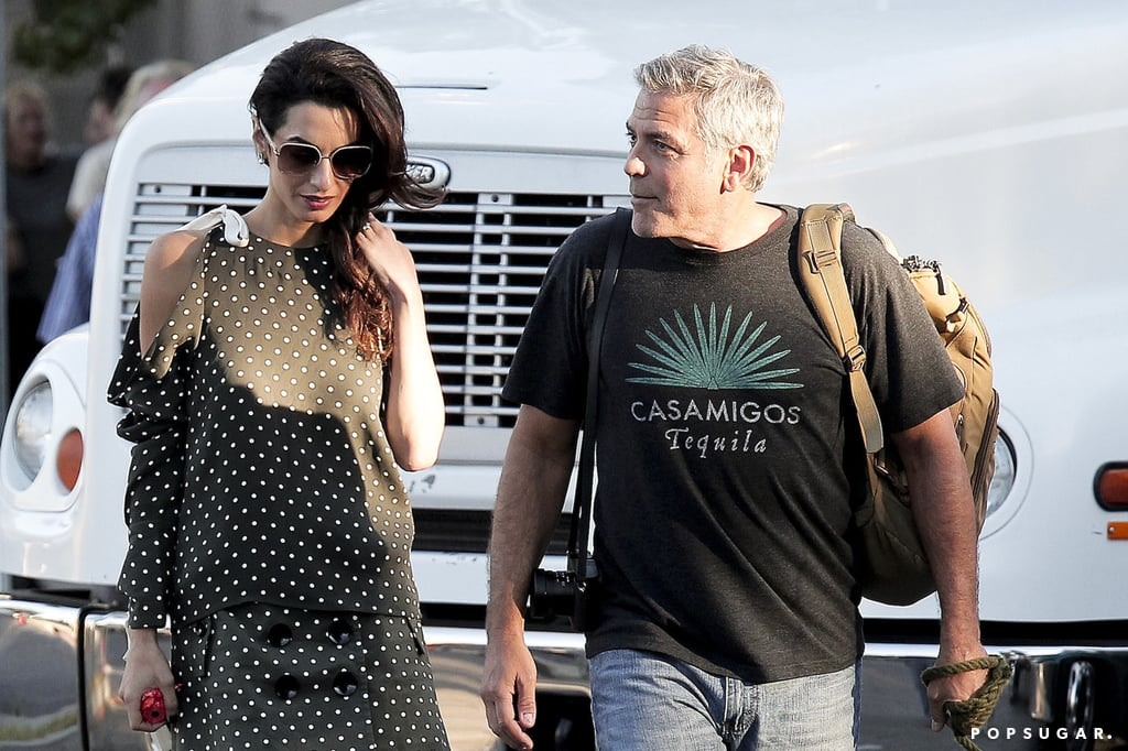 "George Clooney received a special visit from his wife Amal and their adorable Basset Hound, Millie, on the set of his new film, Suburbicon, in LA on Tuesday. The couple, who recently celebrated their second wedding anniversary, were spotted chatting during an afternoon walk. Amal looked effortlessly chic in a printed cold-shoulder top and white booties, while George kept things casual in a Casamigos Tequila t-shirt and jeans.   Over the weekend, the two attended The Motion Picture & Television Fund's annual charity benefit, and while hitting the red carpet, George dished about their recent anniversary, telling Entertainment Tonight, ""And they said it wouldn't last . . . Ah, we proved them wrong!"" He also spoke about how proud he is of his wife and touched on Amal's decision to represent Nadia Murad, a Yazidi woman who was sold as a slave to the terrorist organization ISIS. ""Of course I'm proud of her. Yeah, it comes with risk . . . I think Amal's decision to [represent her] was, of course, heroic,"" he said.       Related:                                                                                                           Look Back at George Clooney's Sexiest Moments Over the Years"
