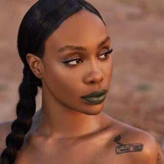 SZA Wearing Fenty Beauty Matte Lipstick