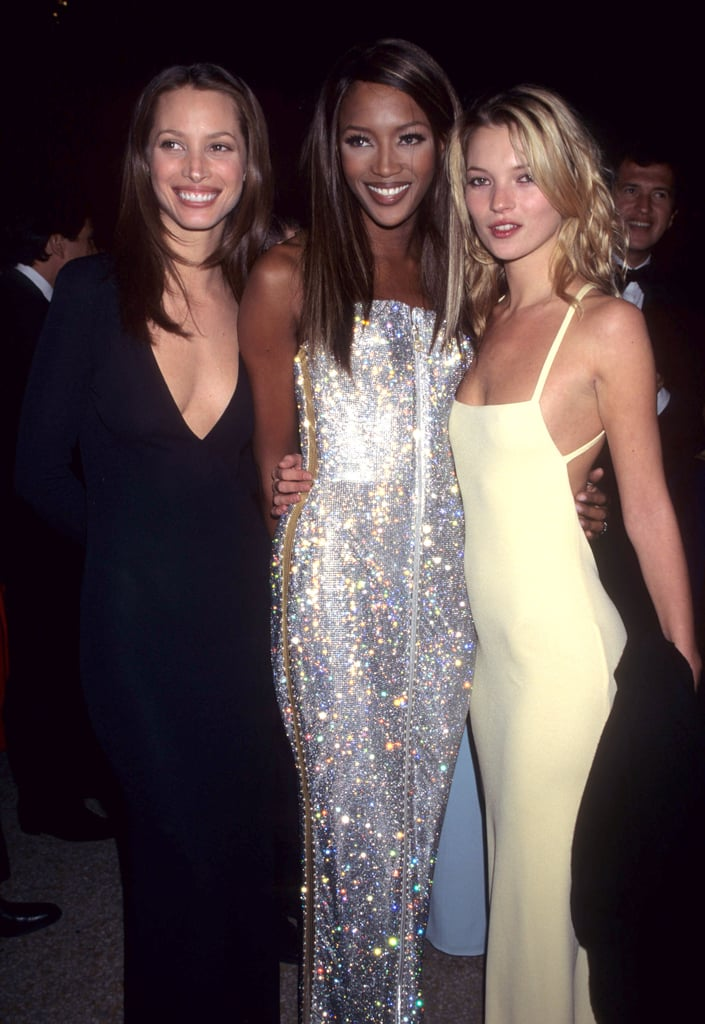 Wearing a pale yellow strappy dress, with Christy Turlington and Naomi Campbell in 1995.