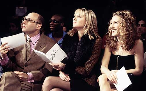 Stanford, Samantha, and Carrie watch a fashion show. Of course, Samantha goes all out in a fur coat.