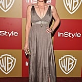 Clea Duvall accented this metallic-shine empire-waist dress with a long pendant necklace.