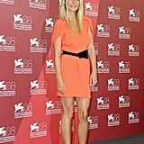 Gwyneth Paltrow wore an orange Prada dress paired with sparkly pumps at the Contagion photo call.