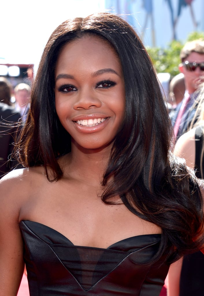 Olympian Gabby Douglas sported a sultry smoky eye balanced with a nude lip gloss, while her hair was slightly curled at the ends.