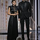 Emma Watson and Robert Pattinson at Golden Globes 2018