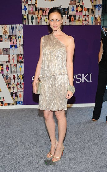 Alexis Bledel wore a nude metallic Behnaz Sarafpour one-shouldered dress — adorable as always.