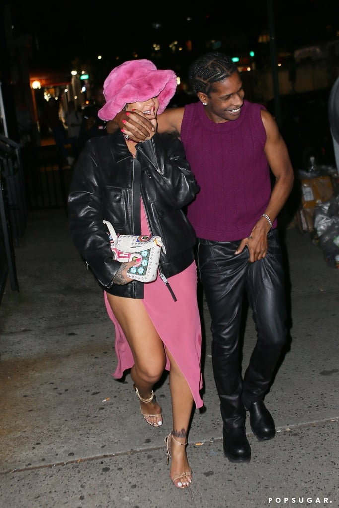 """Rihanna and A$AP Rocky are getting more comfortable putting their romance in the spotlight. On Wednesday night, the couple hit the town in NYC for a date night at Barcade. While A$AP Rocky rocked leather pants and a matching jacket, all eyes were on Rihanna with her high-slit dress and matching pink hat and accessories. Of course, what really caught our attention was their sweet smiles as they left the bar. After sharing a kiss inside, the couple was spotted with their hands intertwined as they laughed their way to the car. The rapper even gave Rihanna his jacket. Aww!  The sweet outing comes a month after A$AP Rocky officially confirmed their relationship status in an interview with GQ. After years of speculation, the rapper confirmed he was dating the Fenty Beauty founder, calling Rihanna """"the love of my life"""" and """"my lady."""" """"[It's] so much better when you got The One,"""" he said at the time. """"She amounts to probably, like, a million of the other ones. I think when you know, you know. She's The One."""" See more pictures from their cute date night ahead.       Related:                                                                                                           Rihanna's Savage x Fenty Surprised Fans With Its First Pride Collection"""