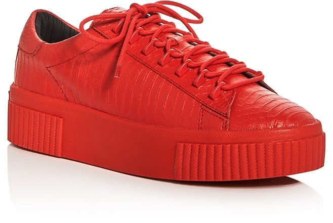 Stand out in bright red with Kendall and Kylie Reese Embossed Lace Up Creeper Platform Sneakers ($130).