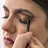 He then creates a winged look by bringing the line down along the upper lash line before blending a bit into the outer corner of the lower lash liner.  Source: Caroline Voagen Nelson