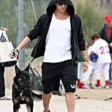 Ryan Phillippe adopted his German Shepherd from a shelter to cheer up his son Deacon and brought the pup along for one of Deacon's football games in LA in June 2011.
