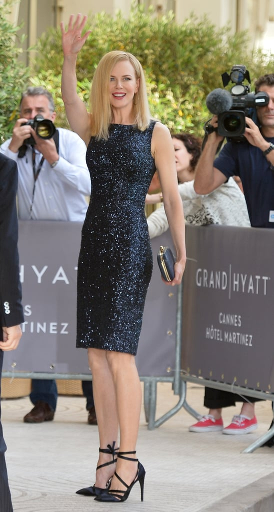Nicole Kidman waved to fans at Cannes and all the while sparkled in a sequined sheath dress and strappy satin pumps.