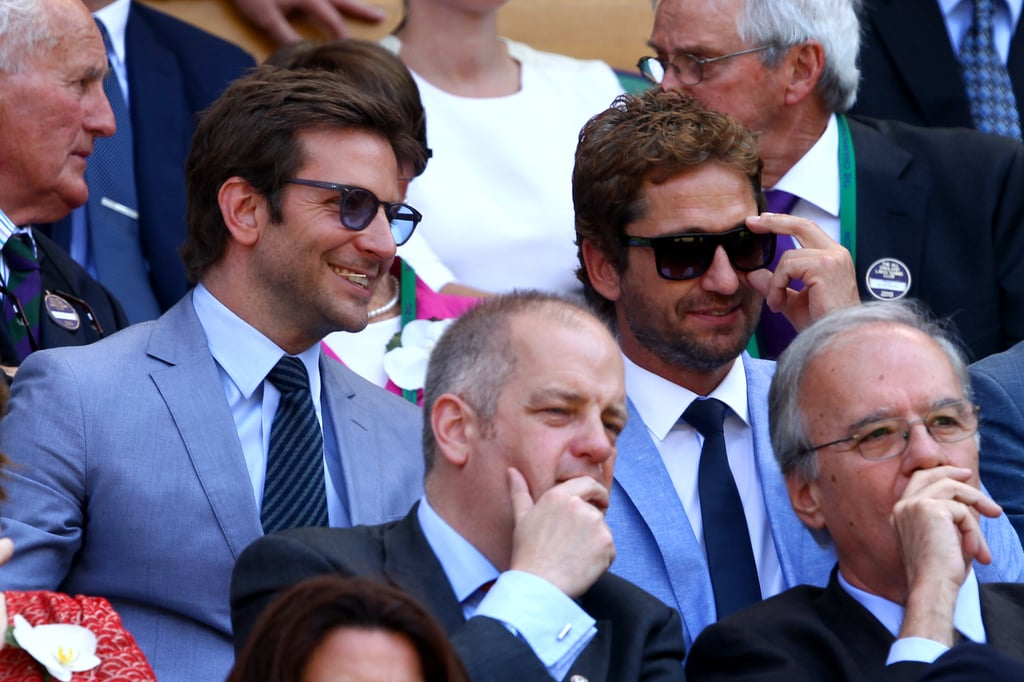 Bradley Cooper and Gerard Butler sported matching blue suits in the stands on Sunday.