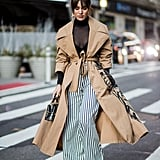 A classic trench coat tones down the effect of graphic stripes.