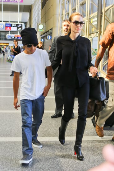 Angelina-Jolie-wore-black-blouse-skinny-jeans
