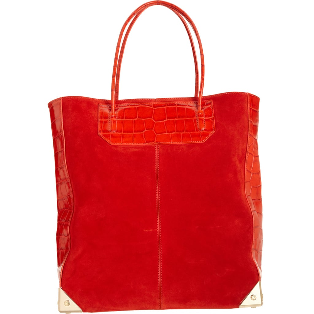 Alexander Wang's practical tote ($329, originally $825) feels special in red suede (with the signature metal corners).
