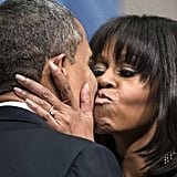 Michelle Obama gave her husband a kiss at the inaugural reception.