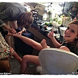 Emma Watson had to get some help taking off her shoes after a long day at Cannes. Source: Emma Watson on WhoSay
