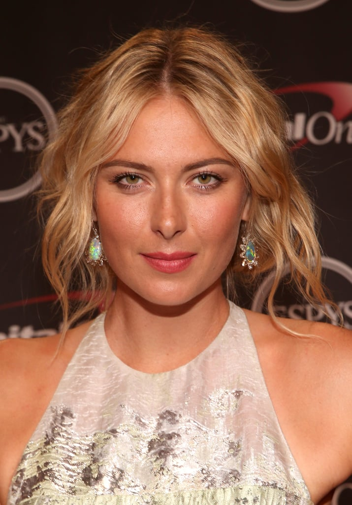 Texture was the key to Maria Sharapova's hair for the night. The style started with beachy waves that were pulled back into a loose chignon.