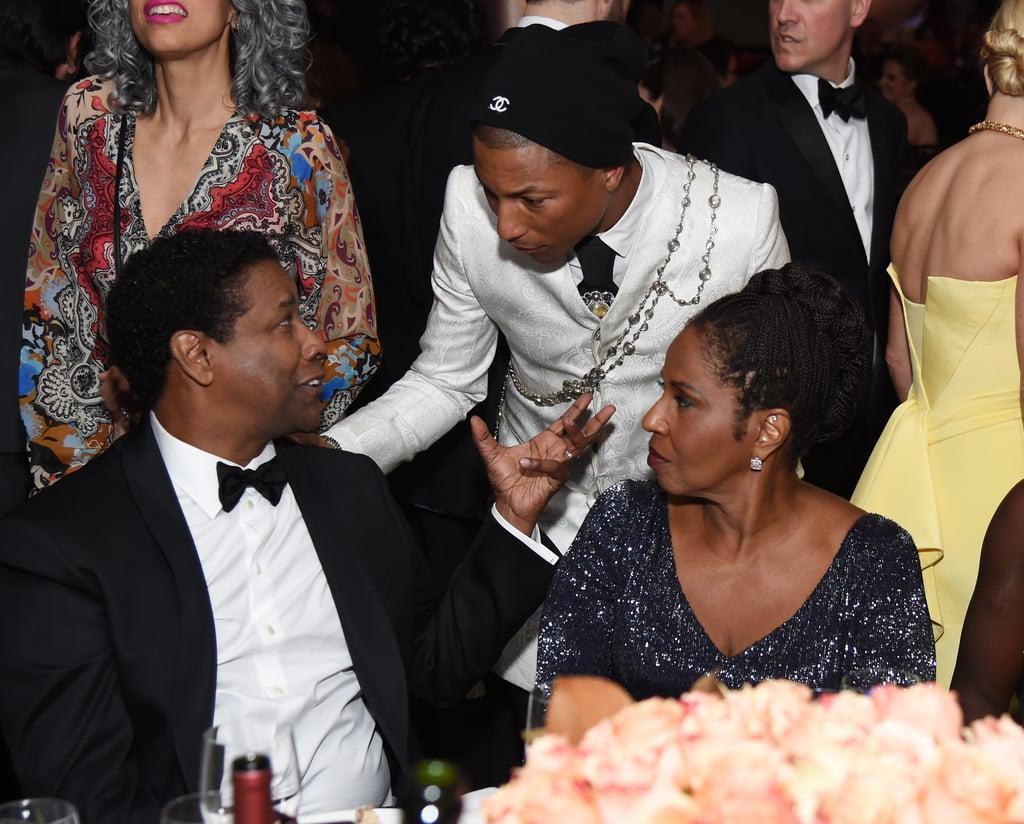 Pictured: Denzel Washington, Pauletta Washington, and Pharell Williams