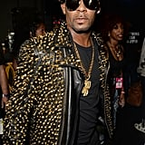 R. Kelly wore a studded ensemble.