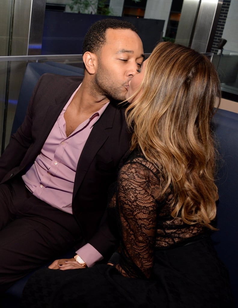 They smooched at a DuJour magazine party in Chrissy's honor in NYC in July 2014.