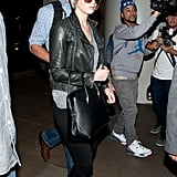 Jennifer Lawrence gave airport style the cool-girl treatment in a pair of black jeans and a green moto jacket.
