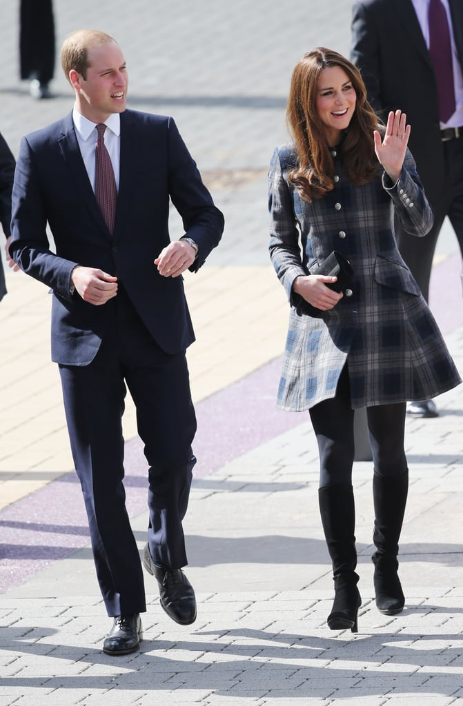 Her Moloh plaid coat-turned-dress featured classic silver button-front detailing and ultratailored pockets.