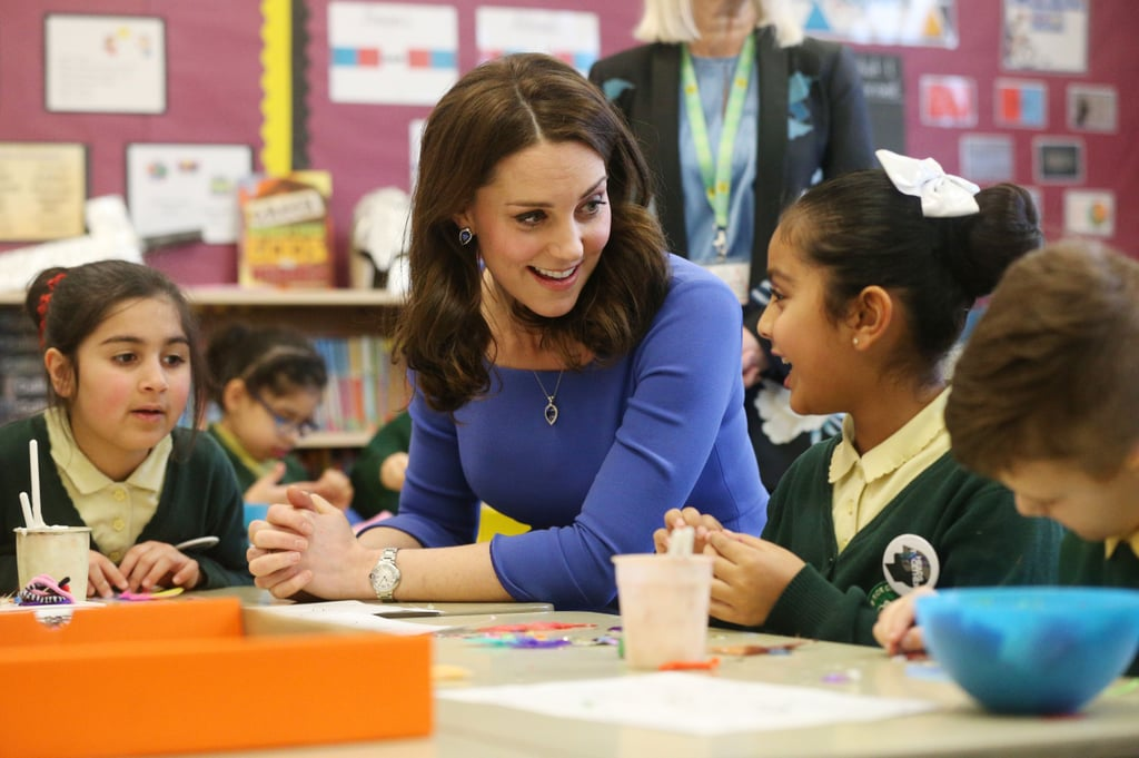 Kate engaged with a young girl during her visit to a junior high school in London in January 2018.