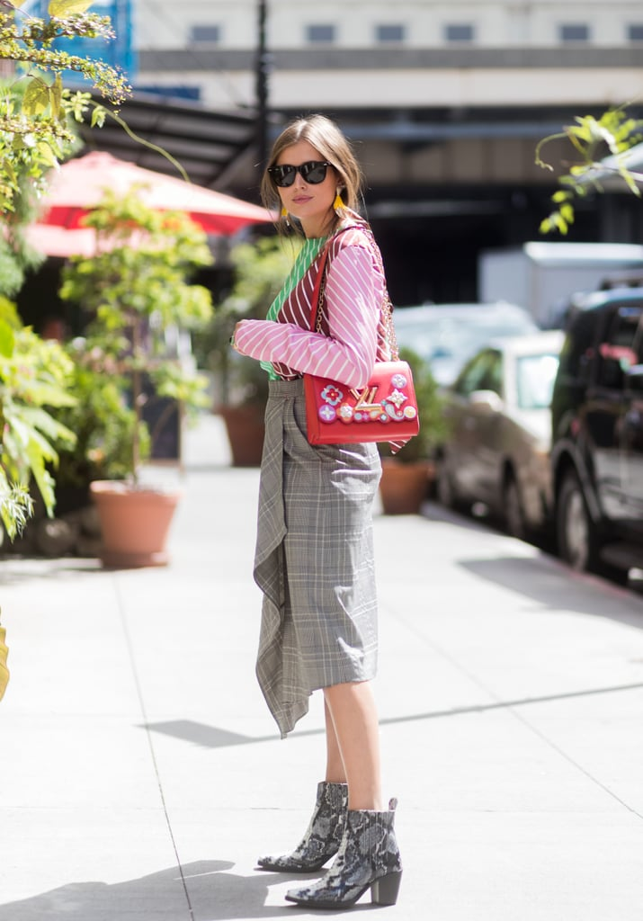 There can never be too much color or print mixing, as Darja Barannik proved. Her multicolor striped shirt paired nicely with her embellished red Louis Vuitton purse.