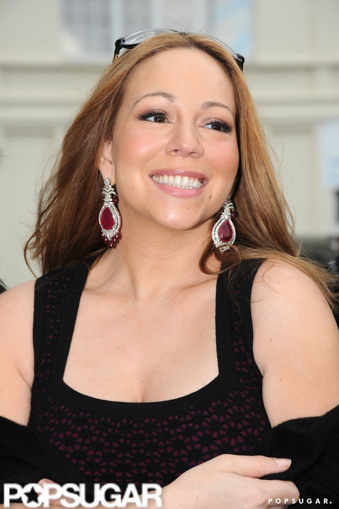 Mariah Carey looked happy leaving Paris after celebrating her 4th wedding anniversary with husband Nick Cannon.