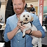 Jesse Tyler Ferguson cuddled up to a pup at an August 2015 Purina event in LA.