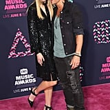 Nicole and Keith got cuddly on the 2016 CMT Music Awards pink carpet.