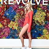 Shea Marie wearing a slitted tunic and sneakers at the Revolve Festival party.