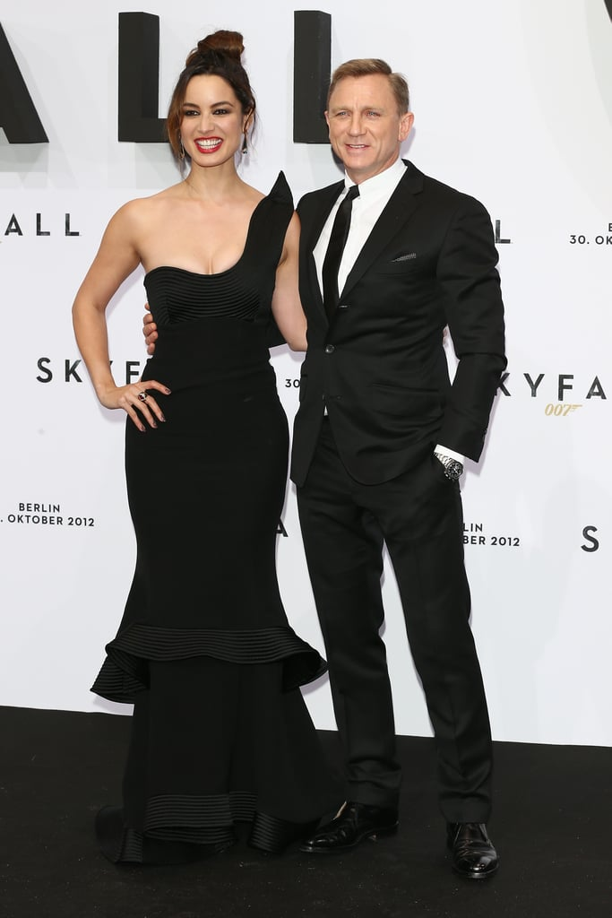 Daniel Craig and his costar Bérénice Marlohe pulled double duty for Skyfall in Germany yesterday. First they met up with director Sam Mendes for a photocall and were later back out in formal gear for the movie's premiere. Bérénice's latest red-carpet look was a black Armani gown. It's been a whirlwind press tour for the Bond cast, who have also stopped in France, Italy, and Spain in the past week. Their Spanish appearance took place on Monday, when Javier Bardem and Naomie Harris joined Daniel for the cameras. All the hard work is clearly paying off since Skyfall is already breaking box office records overseas. The action film will have even more opportunity to dominate theaters when it's released in the US on Nov. 9.