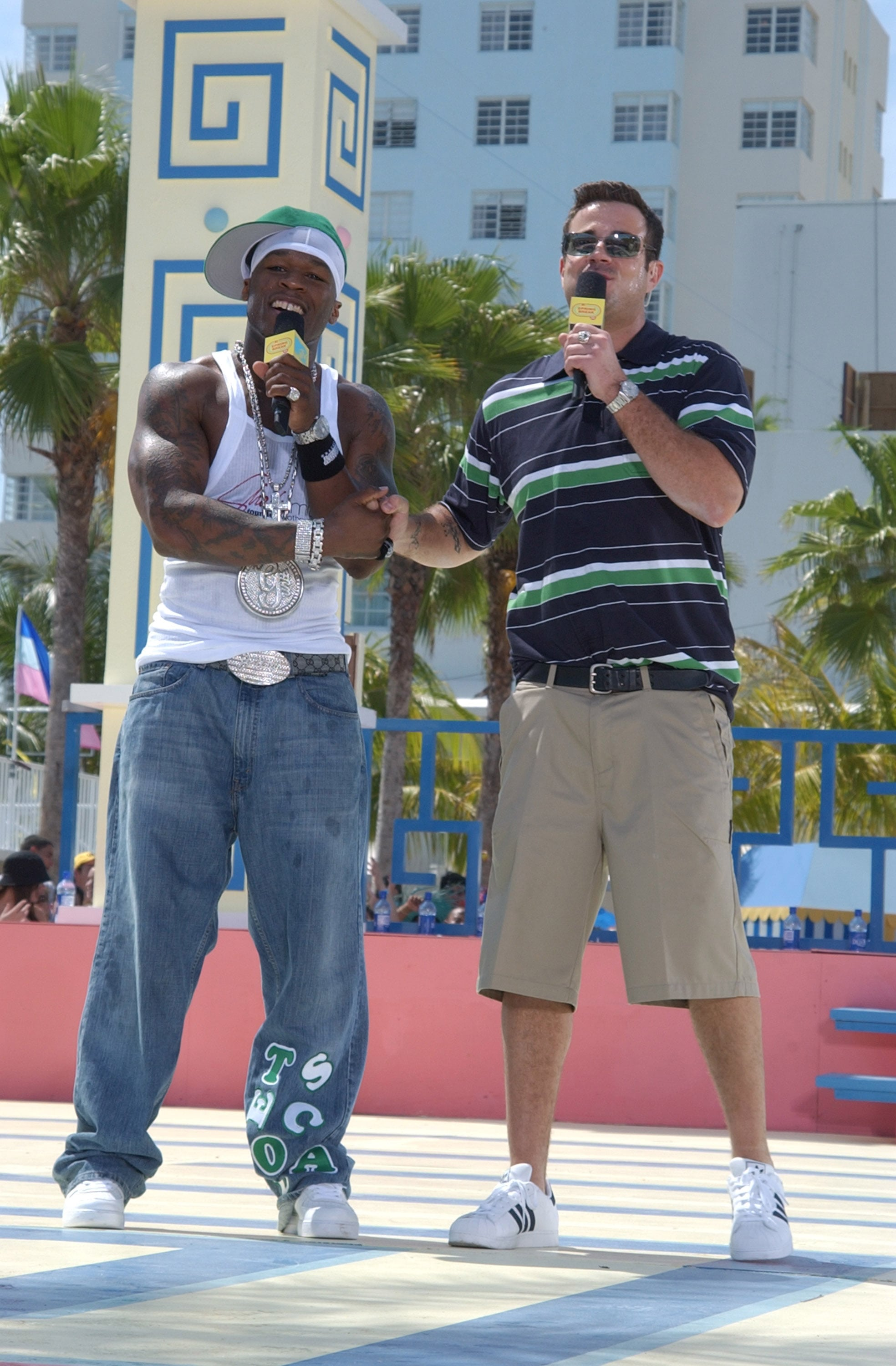 2003: Carson Daly and 50 Cent color coordinate their outfits and share a sweet bro handshake in Miami.