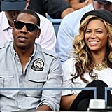 Beyoncé Knowles wears a chic hat to watch tennis.
