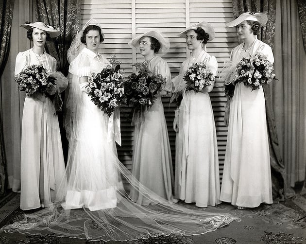 Hats were a key part of this 1937 bridal party look.  Source: Flickr user Striderv