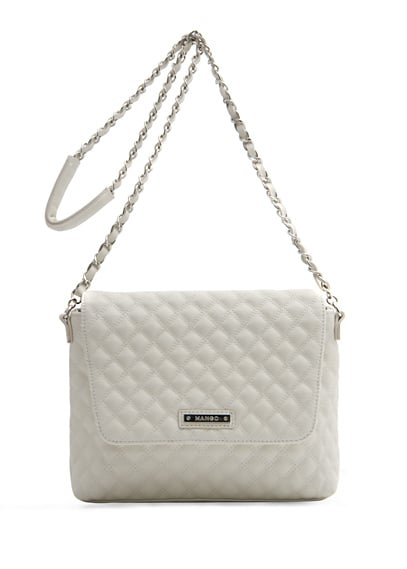 A quilted chain-strap bag for sunny weather, this white shoulder bag looks great against colored jeans.  Mango Quilted Handbag ($50)