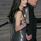 Michael Douglas led Catherine Zeta-Jones into the Vanity Fair Party as she gave a wave at the 2012 Tribeca Film Festival.
