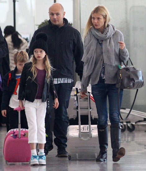 Gwyneth Paltrow touched down at London's Heathrow Airport accompanied by her little ones, Apple and Moses, on Sunday. Gwyneth was makeup-free as she and the kids made their way through the terminal with their luggage. Both Gwyneth and husband Chris Martin have kept busy schedules leading up to the holidays. Last Thursday, Chris took the stage for the 12/12/12 concert in NYC, which benefited victims of Hurricane Sandy. He will return to the Big Apple for another special performance at Brooklyn's Barclays Center to ring in the New Year on stage with pal Jay-Z.  Last week, it was Chris who was on dad duty, though, while Gwyneth headed to LA. Her West Coast travels came after a stop in Dubai, where she attended an event for Boss Nuit. In the midst of the couple's hectic schedules last week, Gwyneth and Chris marked the nine-year anniversary of their wedding.
